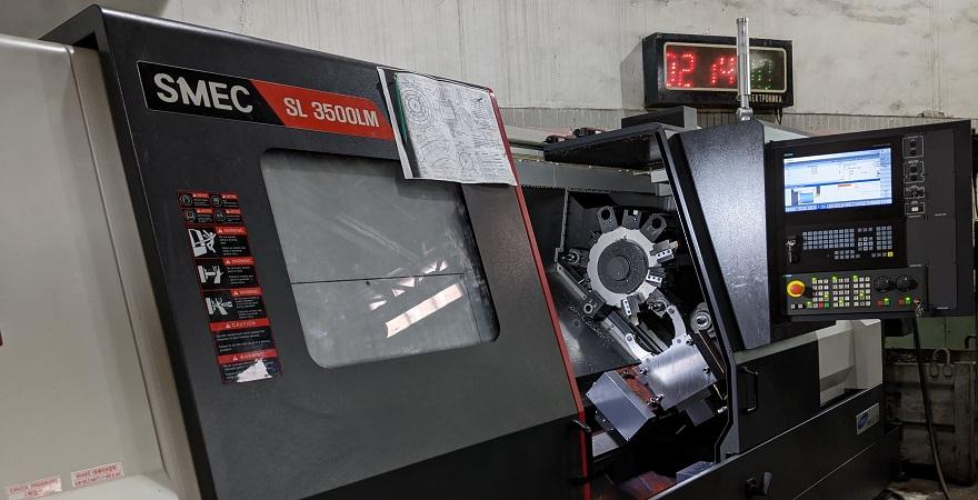 Токарний оброблювальний центр Samsung SMEC SL3500LM із функцією фрезерування на виробничих потужностях  KMZ Industies